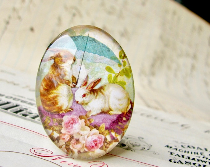 Bunny picnic under an umbrella, oval glass cabochon, 40x30mm or 25x18mm, handmade in this shop, white rabbit, pink roses, green spring