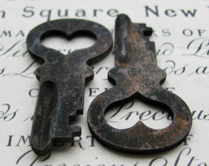 Pair of hearts, two genuine antique safety deposit bank keys, 1.5 inches, rusty, distressed, aged black patina, authentic vintage