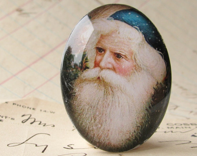 NEW! Victorian Father Christmas handmade glass oval cabochon, 40x30mm, winter holiday, vintage Santa, blue white, 30x40mm, traditional image