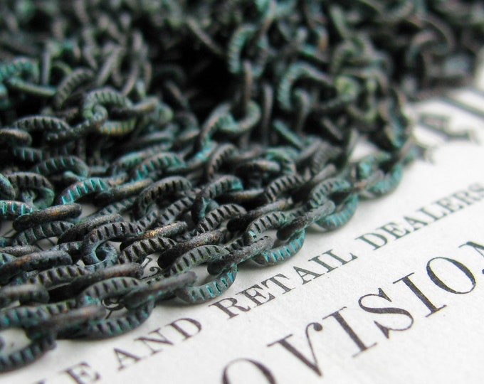 """Verdigris """"Caravaggio"""" textured pure brass chain, 4x3mm, rustic blue green patina over antiqued black, etched flat cable chain (1 foot)"""