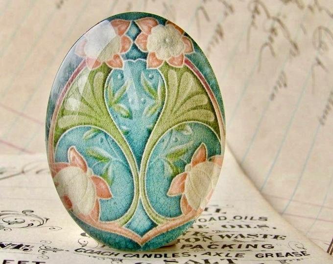 "From the ""Art Nouveau Ceramic Tiles"" series, handmade 40x30mm glass oval cabochon, Belle Époque, blue orange flower, green stem"