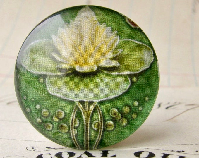 """From """"Art Nouveau Ceramic Tiles"""" 25mm round glass cabochon, handmade, bottle cap, inch circle, white yellow water lily flower"""