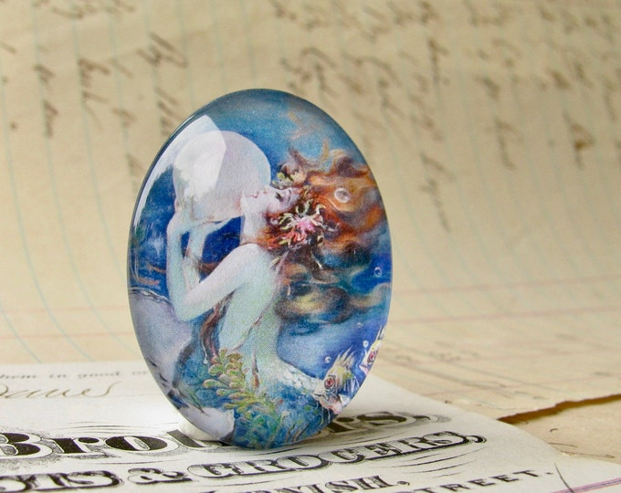 The Mermaid by Henry Clive, handmade 25x18mm or 40x30mm glass oval, bubble mermaid cabochon, white, blue, woman, hair, female ferility