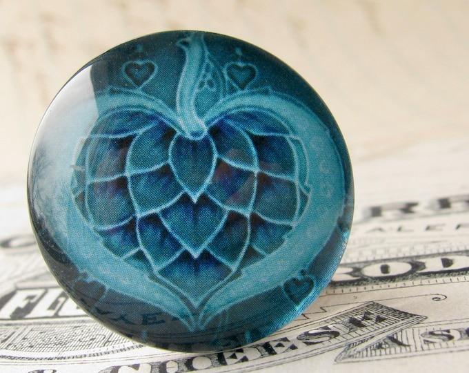 "From the ""Art Nouveau Ceramic Tiles"" series, handmade 25mm round glass cabochon, Belle Époque, turquoise aqua seed pod, blue heart"