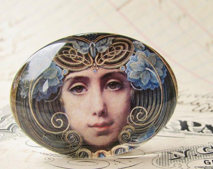 "Handmade glass cabochon - ""Mask"" - 40x30mm oval, horizontal orientation, woman face, blue, swirls, Art Nouveau collection, Louis Hawkins"