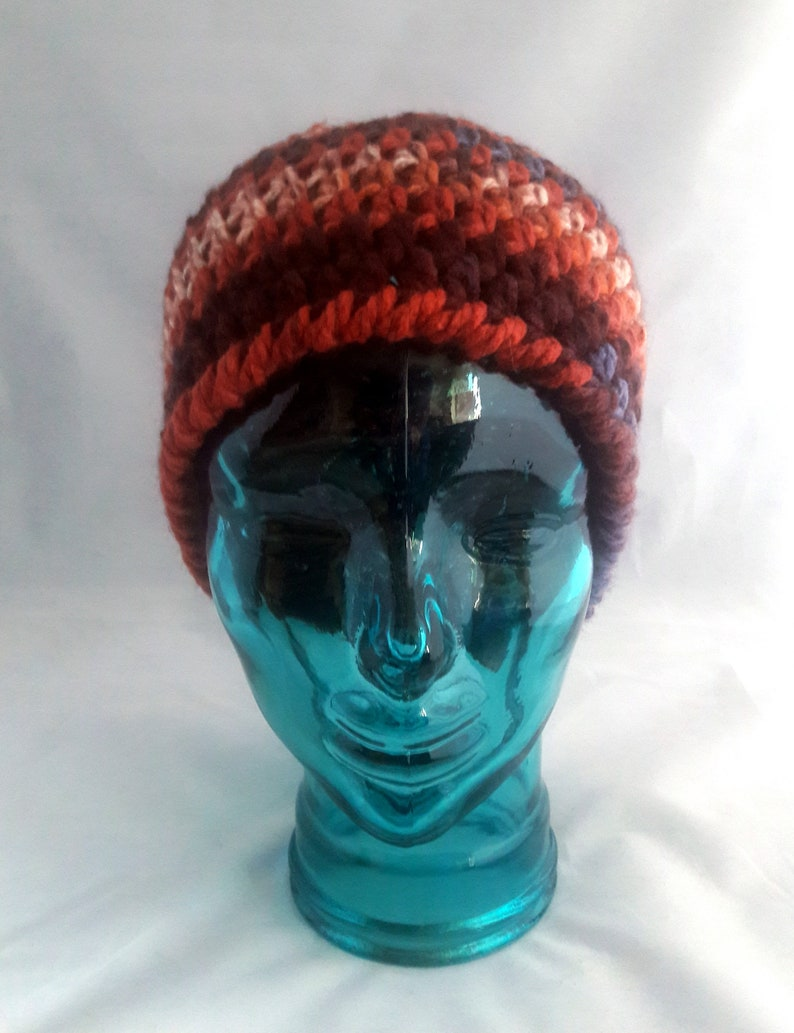 chunky yarn multi-color warm tones Messy Bun hat in Fall colors   Top Knot Beanie with stretch Ready to ship