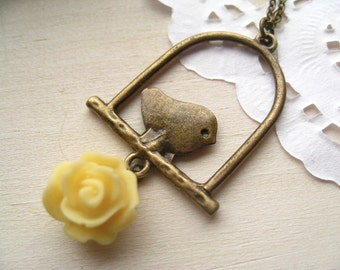 little canary necklace, bird cage charm necklace, dangle necklace, antique brass pendant, yellow rose flower bead, cute jewelry gift idea