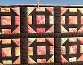 Churn Dash Block Quilt with hand dyed cotton Kona fabric, black sashing and black back, measures 43 by 49 inches