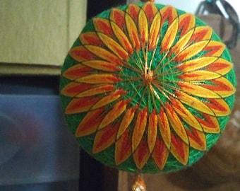 """Japanese Style Temari Ball S24 green with orange starflower and tassel 9"""" circumference"""