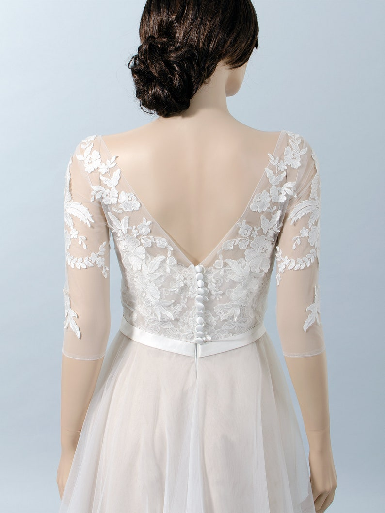 331132c9a28940 Boat neck lace bolero with V back 3 4 length sleeves bridal