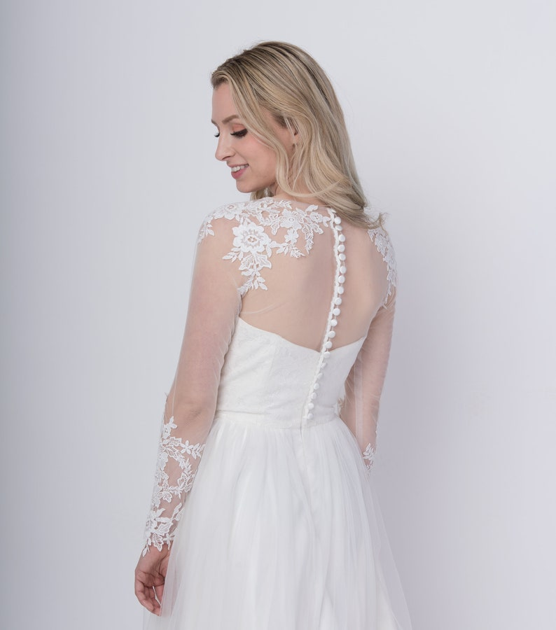 Light ivory long sleeve wedding dress topper buttoned back image 0
