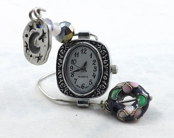 Mini table clock for any to remind people of magic in the moon charm and romance in the pink and green circular bead with fancy clock face.