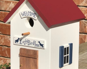 Early Bird Inn with Navy Shutters and Red Roof