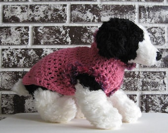 Dog sweater in pink with fur trim, size med., large. fancy pink sweater,