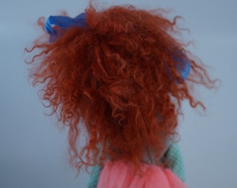 Wow!  Bold bright orange red mohair wig.