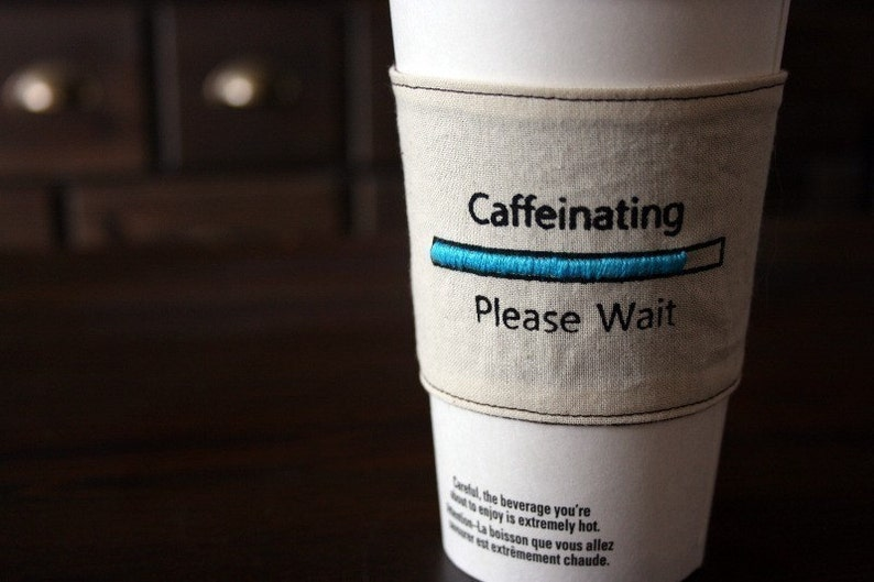 Caffeinating please wait cup cozy image 0