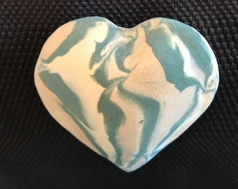 Find it in your heart to bring the joy back. Hear the soothing sounds from this handmade clay heart rattle; start the healing, with gift box