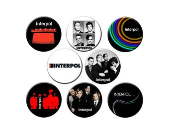 "8 Interpol Designs Choose 8 Small 1.25"" Pins, 1 Lg 2.25"" Pin or Magnet or 1 Lg 2.25"" Fridge Magnet"