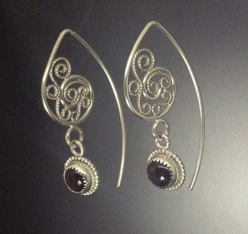 Gorgeous filigree earrings with garnet drops in silver with image 0