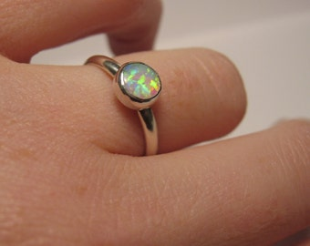 Simple and elegant opal ring in sterling silver for stacking or solo wear multicolored pink blue green white