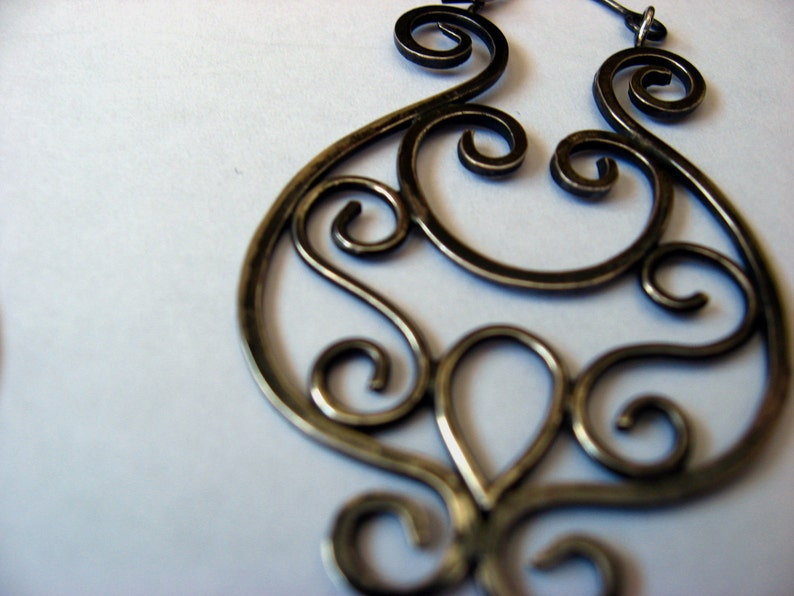 Silver wire scroll earrings with patina image 0