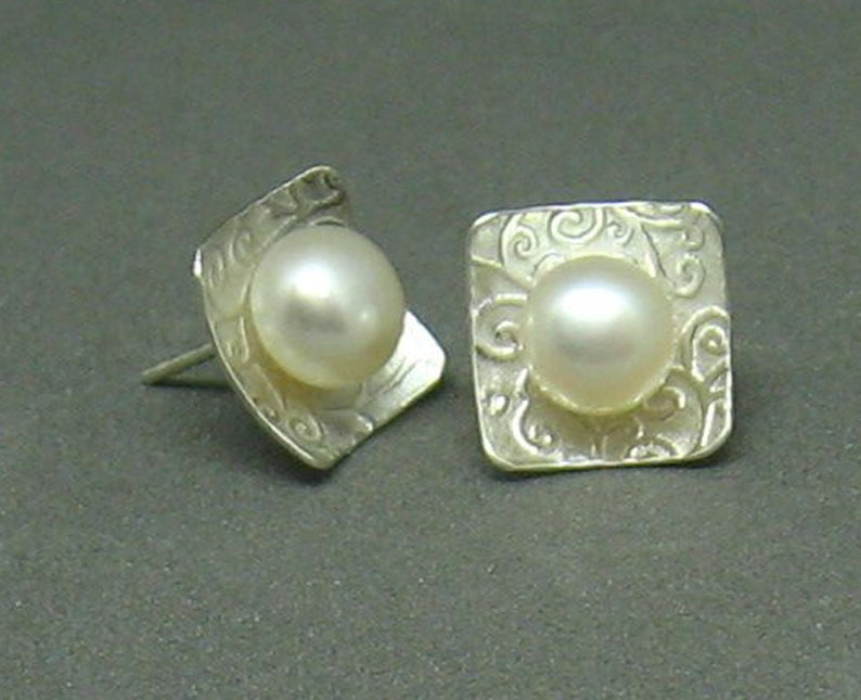 Pearl and Sterling silver post earrings with swirly textured image 0