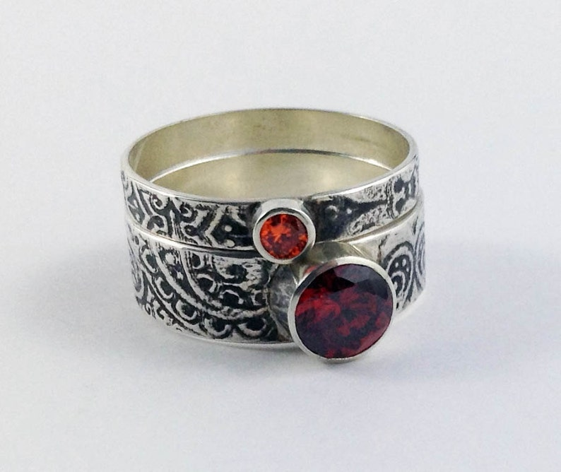 The Autumn Stack ring set in garnet and topaz coloured stones image 0
