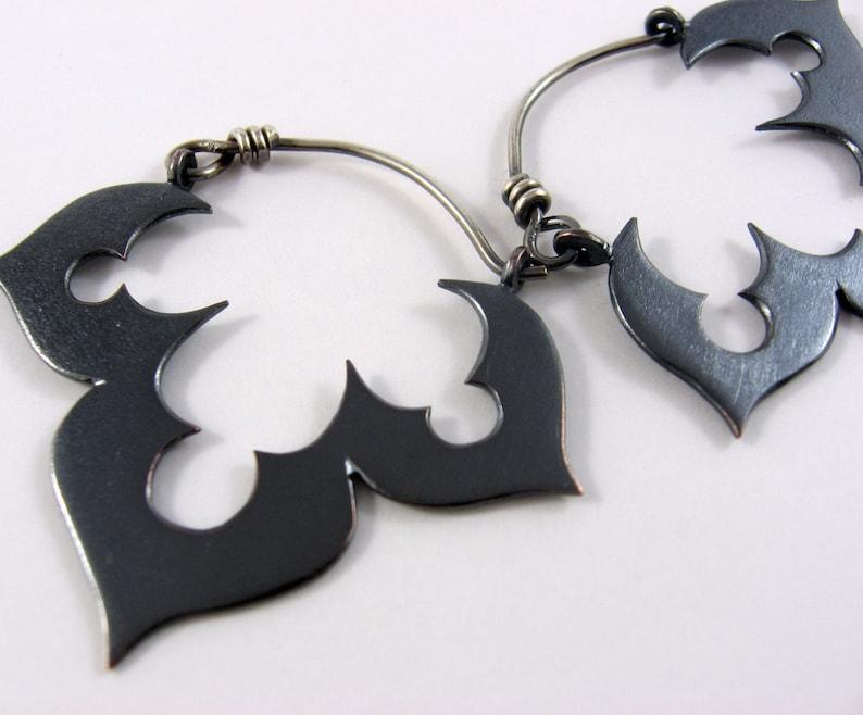 Genie's black lotus earrings in copper and sterling image 0