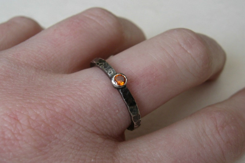 Distressed sterling silver stacking ring with orange cubic image 0