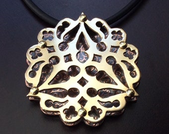 Gothic Trillium Pendant in blackened patterned copper and shiny gold toned brass riveted mixed metals