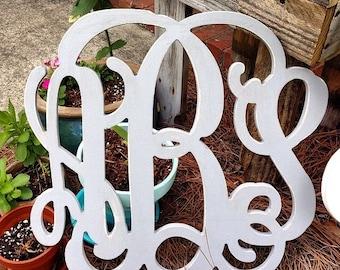 "24"" unfinished monogram, vine font measures approx  24""x24"""