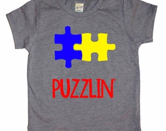 5d02bbd74 Puzzlin' Tee, Autism Awareness Shirt, Autistic Kids Tee, Autism, Puzzle  Autism, Kids Graphic Tee, Boy clothes, girl clothes, toddler shirt