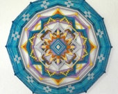 Magic moment, a 24-inch, 12-sided ojo de dios, in stock by Jay Mohler