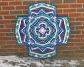 Eye of the Storm, a 36-inch, 12-sided mandala by Inga Savage in stock
