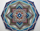Sweetbriar, an 18 inch, 8-sided Ojo de Dios, all wool yarns,