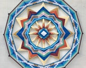Red Rock Sun, a 24 inch Ojo de Dios, Currently in stock by Sami