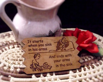 It starts when you sink in his arms kitchen plaque - wedding shower gift - SET OF TWO