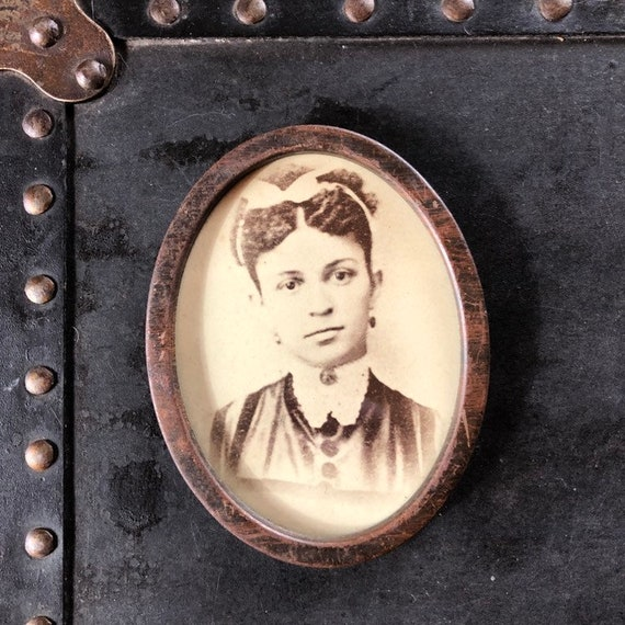 rare, early African American girl albumen photograph in original oval frame
