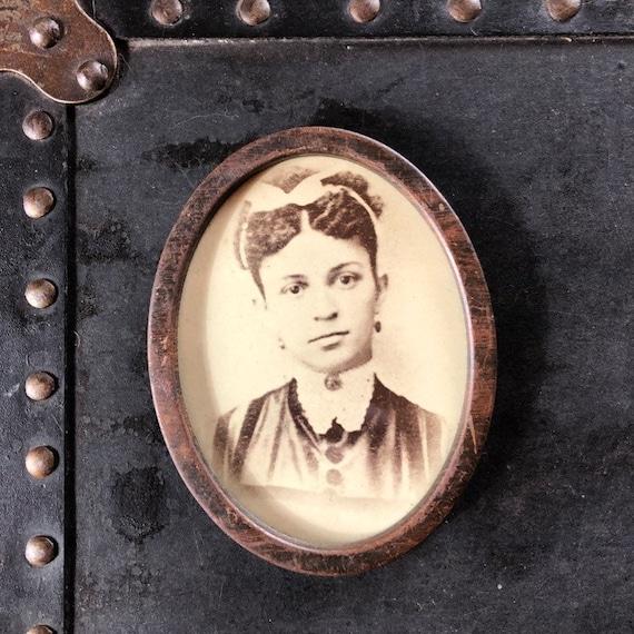 rare, early African American girl albumen photograph in original oval frame