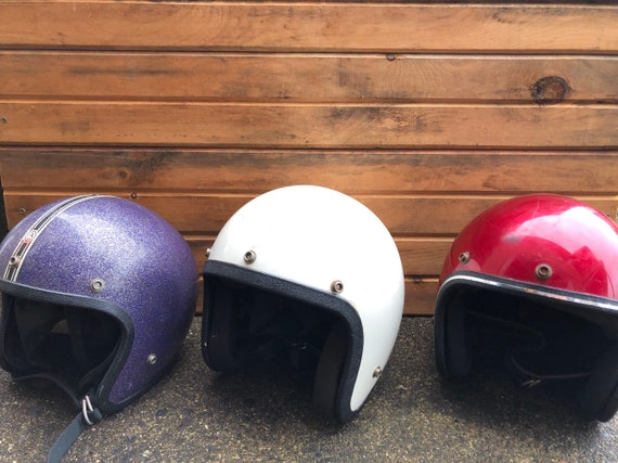vintage trio of motorcycle helmets