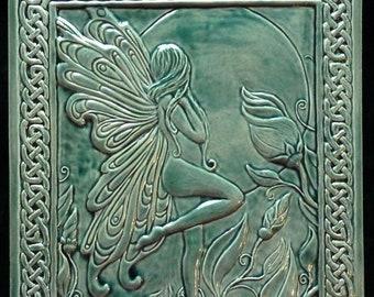 Decorative relief carved ceramic Celtic faerie tile