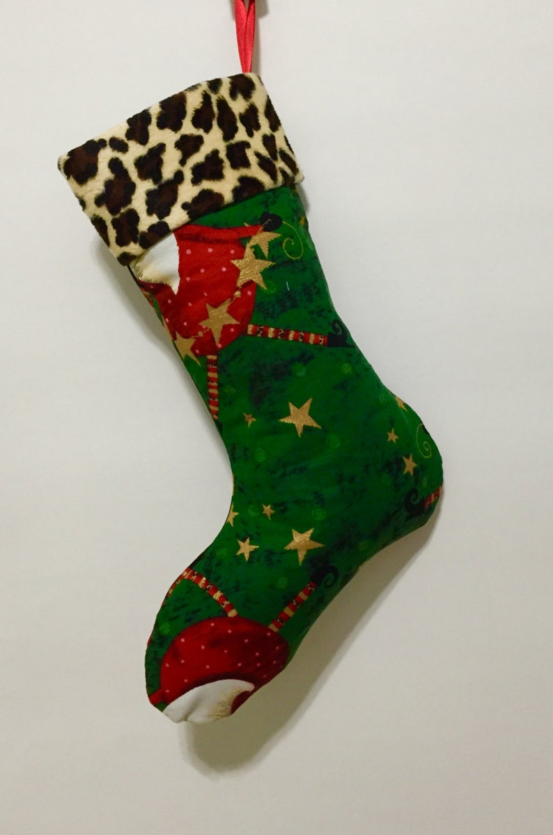 Whimsical Santa wearing Faux fur hats on Green Background with Faux Cheetah fur Cuff
