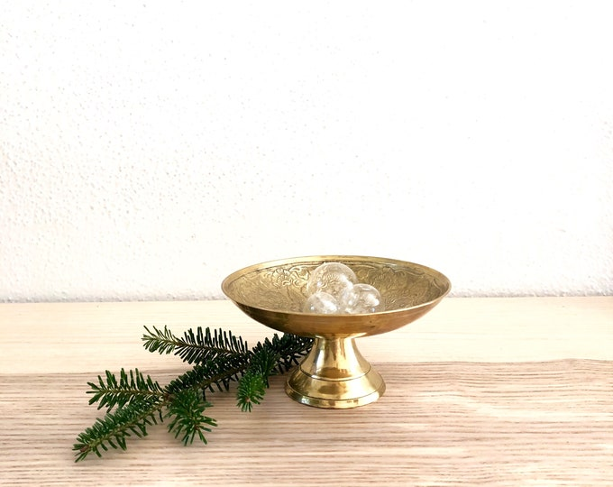 Brass pedestal dish with engraved interior