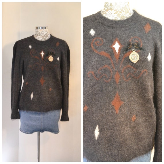 West Germany Mohair Sweater in Charcoal Grey w/ Diamond, Fleur de Lis, Velvet Ribbon & Gold Pendant Details. Small - Med