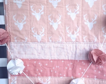 pink/peach cot quilt
