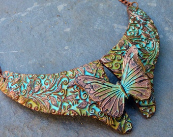 The kiss of the butterfly copper and patina polymer clay necklace