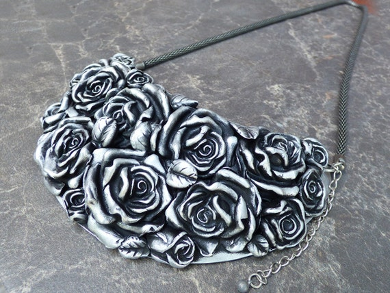 Distressed silver rose bouquet bib necklace