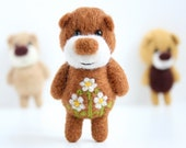 Felted light brown miniature pocket bear with flowers