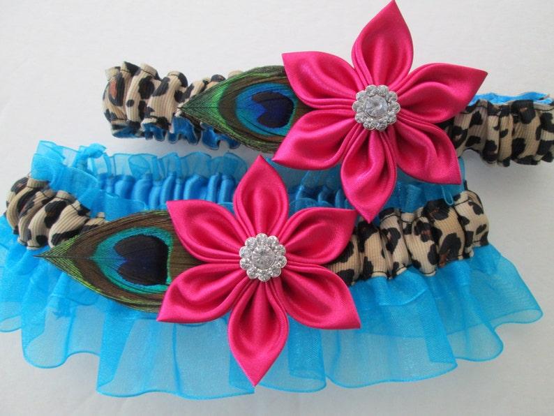1c7ef00a6b9 Peacock Wedding Garter Set Pink   Blue Garters Cheetah
