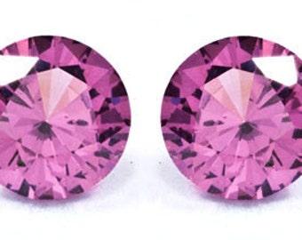 Umbalite garnet pair matched 5.0mm round cut  1 1/4 carat total weight